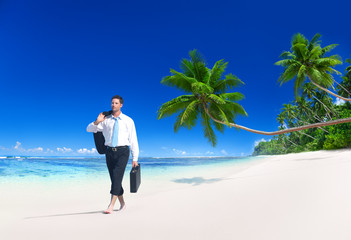 Businessman Walking Along Tropical Beach Concept