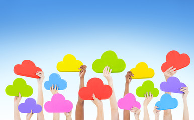 Hands Holding Multi Colored Cloud Shaped Speech Bubbles Concept