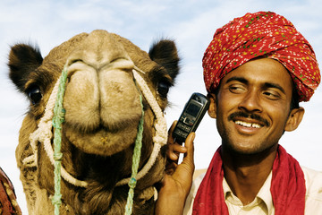 Asian Man Camel Desert Communications Mobile Phone Concept