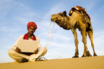 Indigenous Indian Man Laptop Desert Concept