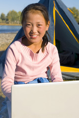 Happy Mongolian Girls with Laptop at Campsite