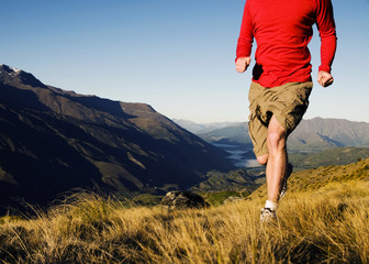 Man Jogging In A Beautiful Mountain Scenic
