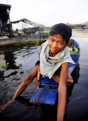 Boy Traveling Boat Floating Village Happiness Concept