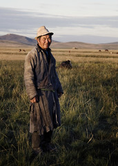 Mongolian Milking Man Standing Scenic Field Concept