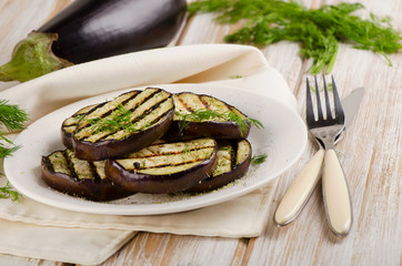 Grilled eggplant slices on a wooden table