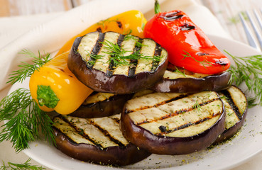 Grilled vegetable  slices on a white plate