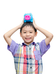 Asian smiling boy with piggy bank isolated on white