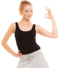 Fitness sporty girl showing ok okay hand sign gesture