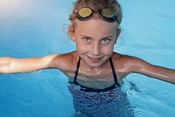 Youthful girl swimming in a pool