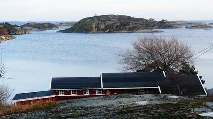 Rocky island on the fjord
