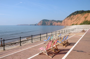 Deckchairs on seafront at Sidmouth in Devon