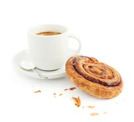 Cup of coffee next to cinnamon bun