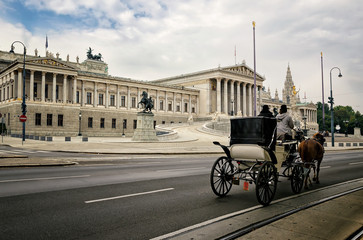 Carriage with horses in front of the Austrian Parliament