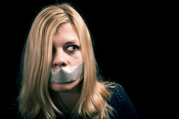 Kidnapped woman hostage with tape over her mouth