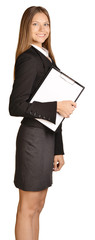 Business woman standing sideways and holding in hand clipboard.
