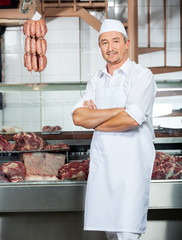 Butcher Standing Arms Crossed In Butchery