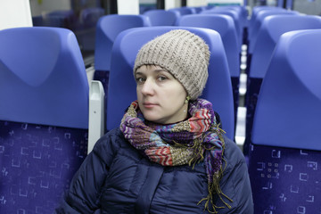 Serious woman in a train