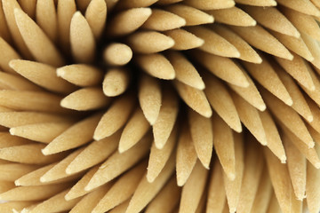 Several wooden toothpicks abstract background