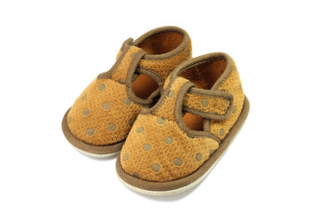 worn baby shoes on a white background
