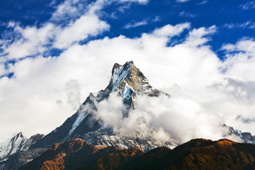 Machapuchare mount over clouds, Nepal