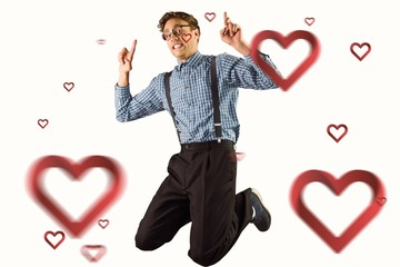 Composite image of geeky hipster jumping and pointing