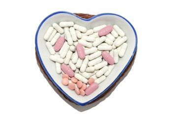 medicaments in a porcelain dish in the shape of a heart