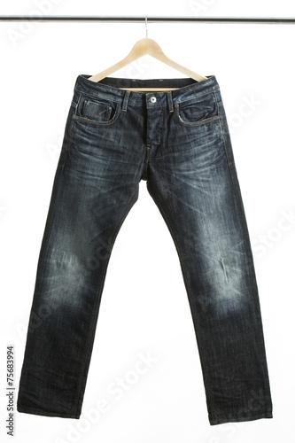 canvas print picture Jeans auf einem Kleiderbügel