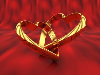 Two gold hearts on a red with the words I love you