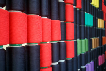 Row of colorful sewing thread