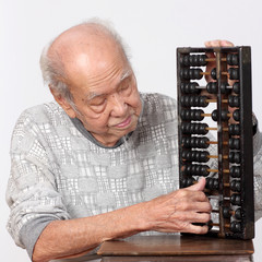 old man and chinese abacus