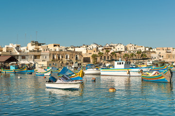 Traditional luzzu boat at Marsaxlokk village, Malta