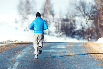 Fitness man, jogger running, preparing and training outdoor