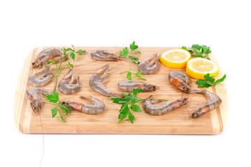 Fresh shrimps on wooden board.