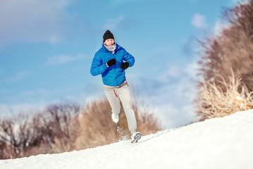 Athlete running on snow, preparing for hard training