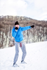 fighter doing a practice training on snow, exercising kicks