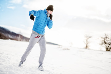 Athlete having a workout out on snow, fitness concept