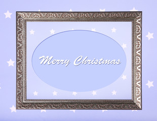 Christmas greeting card with frame on purple background