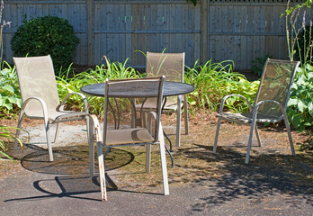 Outdoor lawn furniture in a garden setting