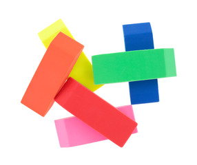 Several erasers on a white background.