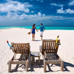 Couple running on a beach at Maldives