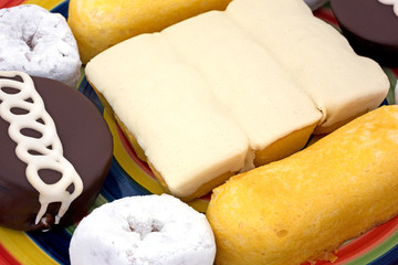 Close view of junk food cakes and donuts