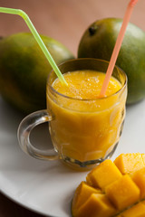 The glass of homemade mango smoothie