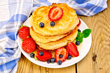 Flapjacks with strawberries and blueberries on board