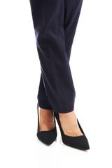 Close up on businesswoman slim legs in high heels