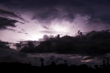 Thundercloud illuminated by lightning
