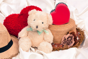 mini bear and red heart on white cotton
