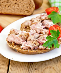 Sandwich with brains in oval plate on board