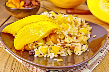 Pilaf fruit with pumpkin in brown plate on board