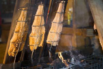 Salmon on smoking stand with natural wood smoke
