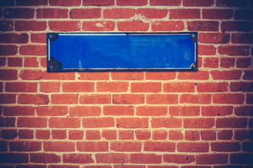 Blank Sign On A Brick Wall